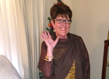 Liz added a silk georgette wrap and pants to her bought dress